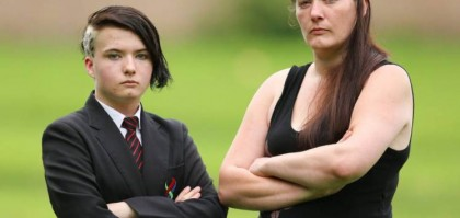 Lauren Mcdowell 13 with mum Yvonne Mcdowell,  showing the haircut she was sent home for, at Forge Valley School in Stannington, Sheffield.  See rossparry copy RPYHAIR: The mother of a schoolgirl who was sent home for her leopard-print hairstyle is slamming the decision - as a breach of her human rights. Yvonne Mcdowell, 34, has hit out after her 13-year-old daughter, Lauren, was sent home on the first day of the new term. Now the mum is refusing to change Lauren's leopard print hairstyle as she believes it breaches her daughter's human rights.The hairstyle is shaved on one side of Lauren's head which is dyed brown and blond.