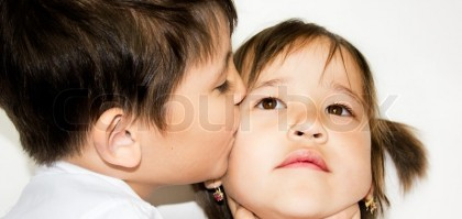 4387758-a-boy-kissing-a-girl-on-a-white-background