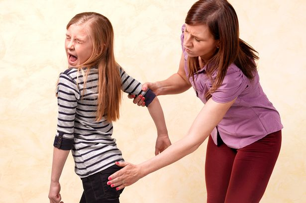 Mother-smacking-10-year-old-daughters-bottom
