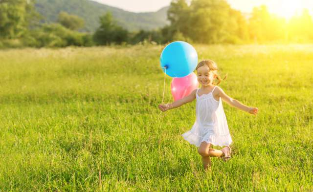 girl-running-with-balloons