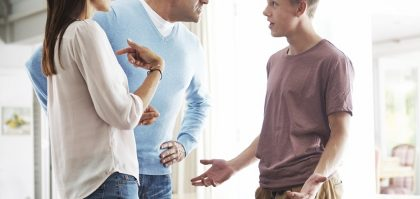 A teenage boy in an argument with his parents